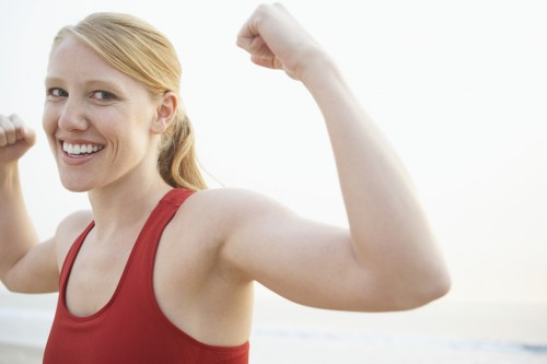 Woman flexing arms